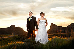 Sunset in Scotts Bluff with larger then life Bride and Groom