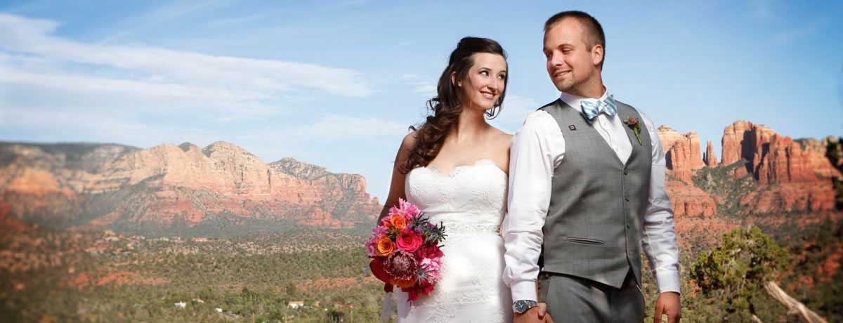 Wedding couple poses for a photo with Red Rock State park in the background