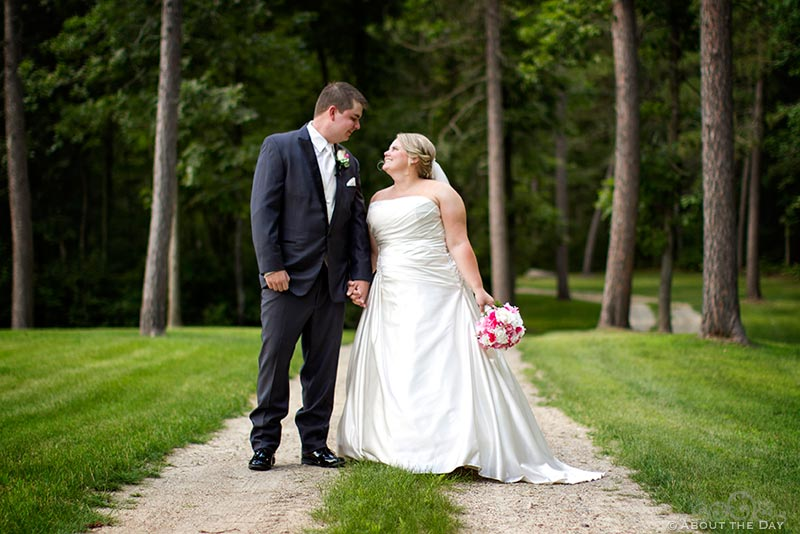 Bride and Groom walk along gravel driveway in Cass Lake, Minnesota