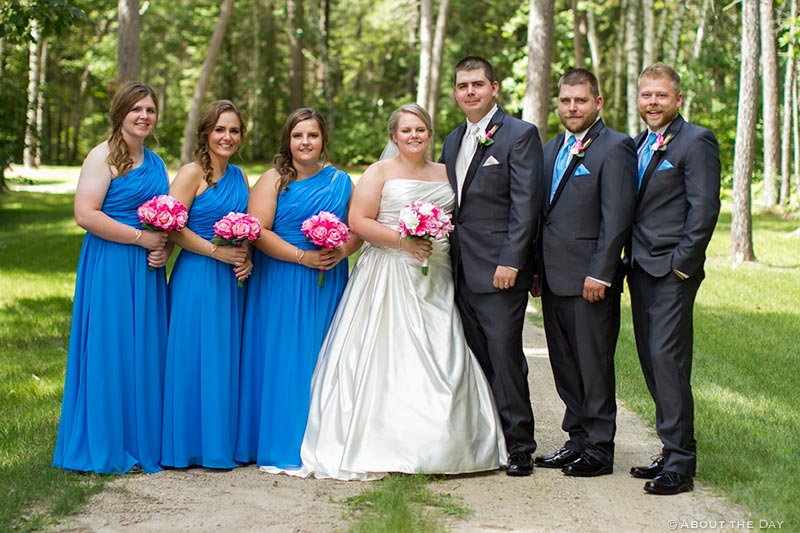 Wedding party poses along gravel driveway in Cass Lake, Minnesota