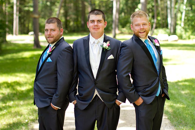 Wedding party guys pose along gravel driveway in Cass Lake, Minnesota
