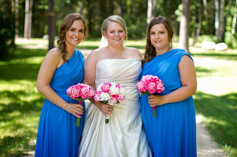 Bride and her sisters pose along gravel driveway in Cass Lake, Minnesota