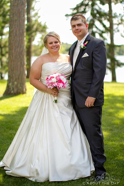 Bride and Groom pose together near Cass Lake, Minnesota