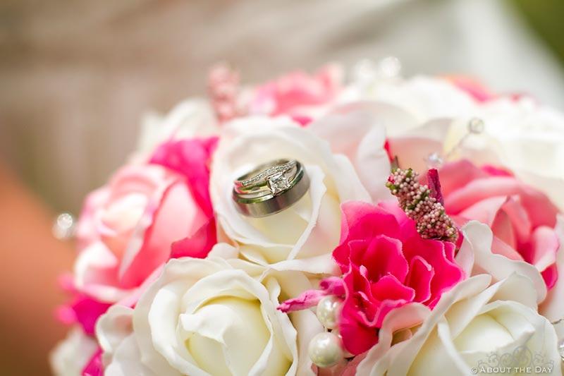 Closeup of wedding rings on flowers near Cass Lake, Minnesota