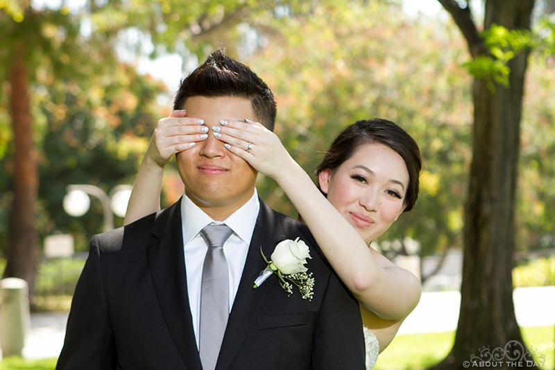 Bride covers the Grooms eyes before he sees her for their first look