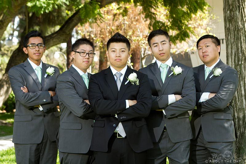 Groom and groomsmen pose together