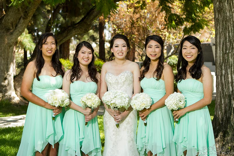 Bride and bridesmaids pose together
