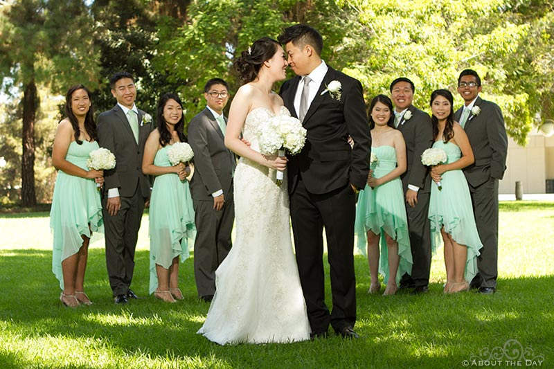 Birde and Groom stand in front of their wedding party