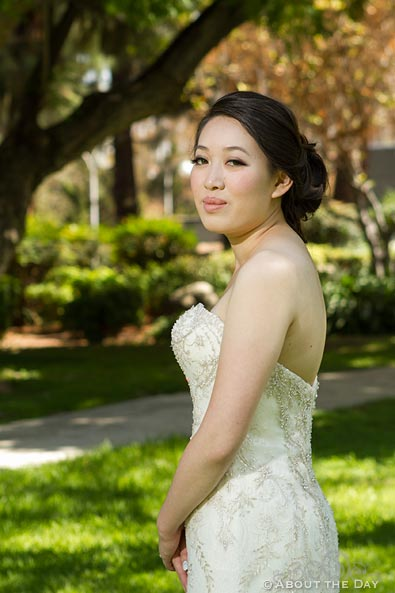 Lovely bride poses in the park