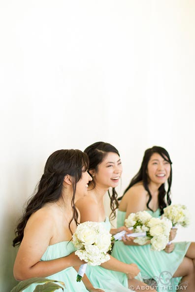 Bridesmaids laugh at a funny joke