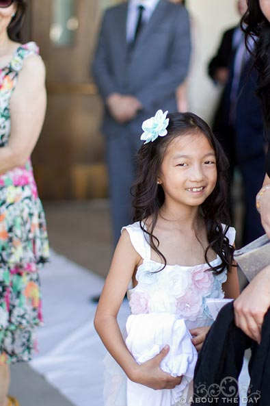 Flowergirl smiles for a candid photo