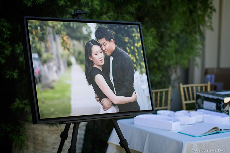 Bride and Groom show off their engagement photo in a frame