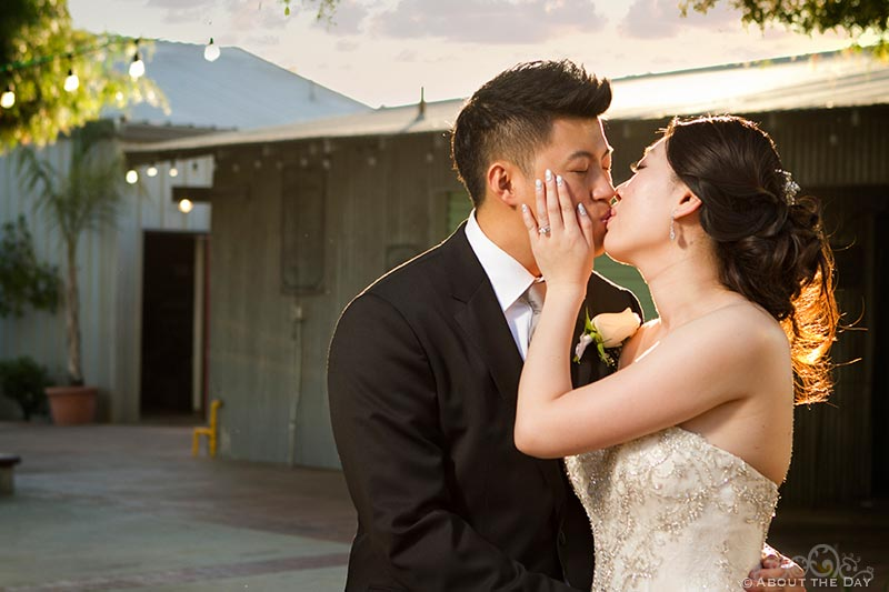 Bride and Groom kissing in lowering sunlight at Hurst Ranch
