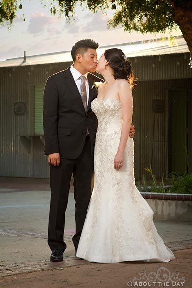 Bride and Groom kiss in the dying light at Hurst Ranch