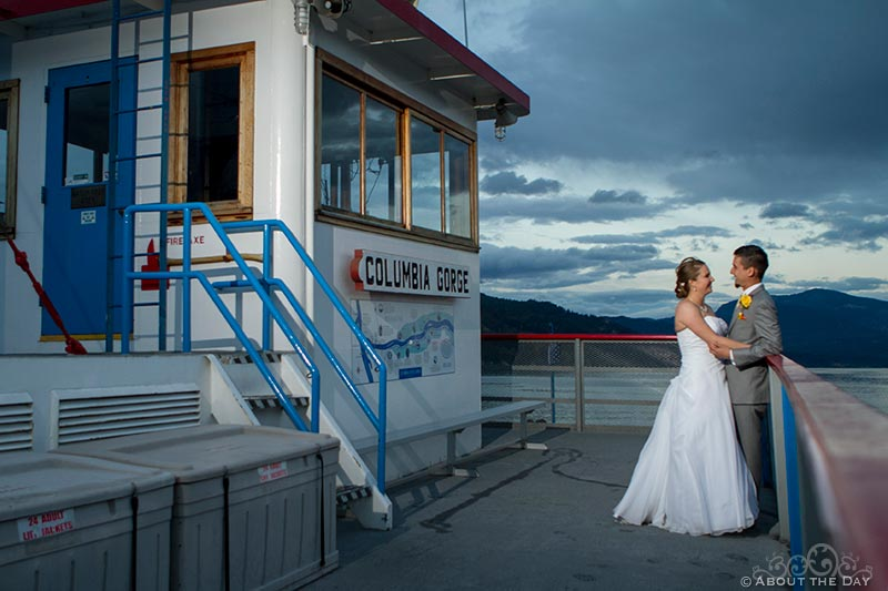 Bride and Groom at the wheelhouse of the Sternwheeler Columbia Gorge