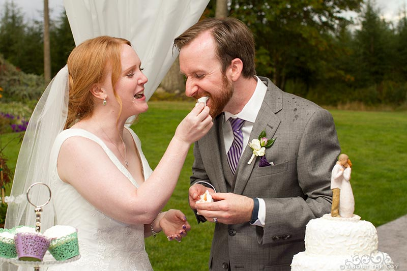 Bride feeds cake to Groom at Natures Connection in Arlington, Washington