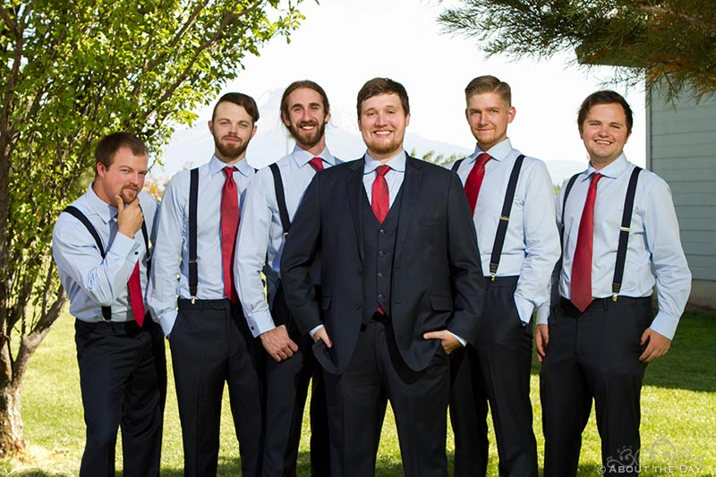 Groom and his groomsmen pose for a portrait