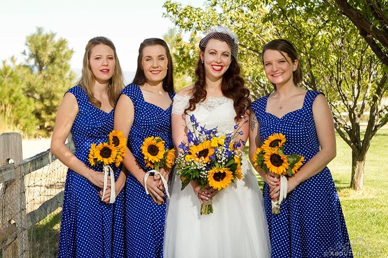 Bride and her bridesmaids pose for a portrait