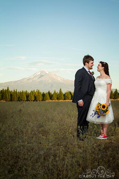 Bride and Groom stand with view of Mt.Shasta