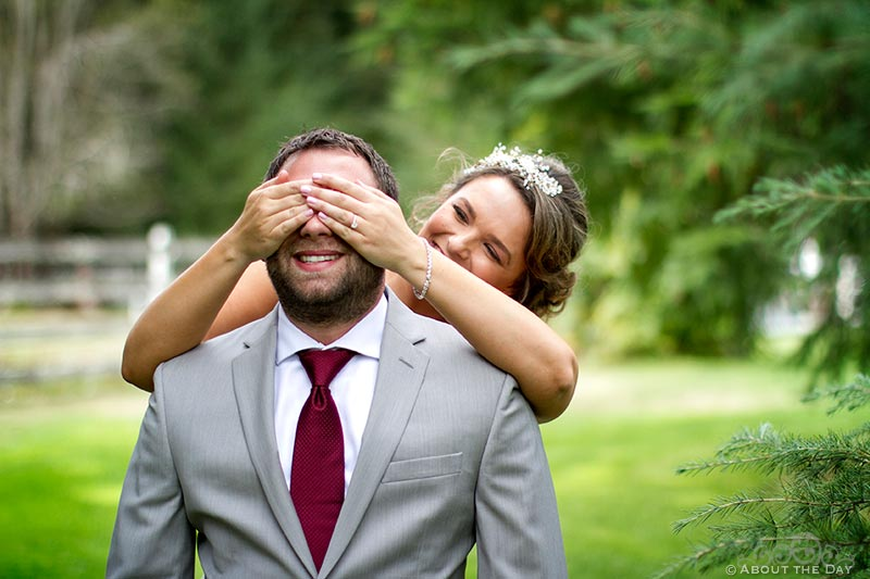Bride covers Grooms eyes during their first look