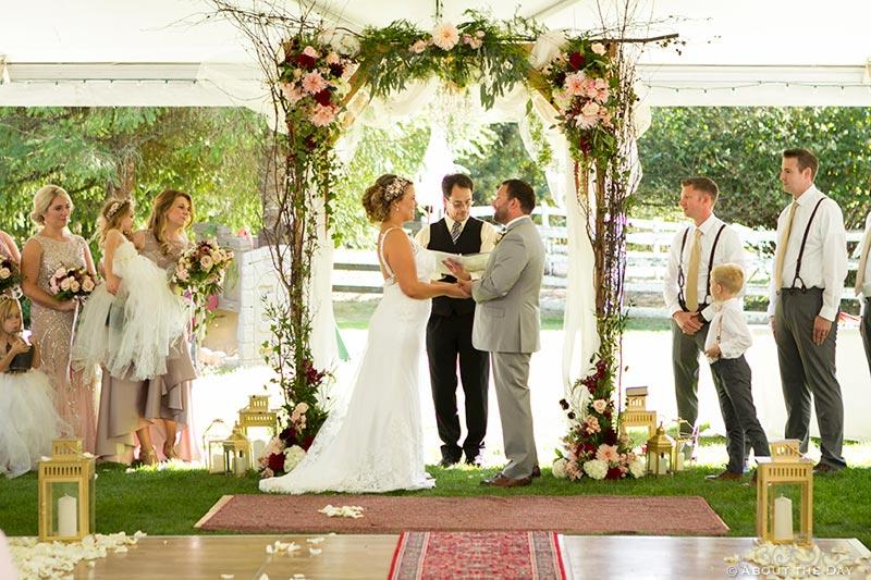 Wedding vows under a white tent
