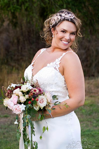 Lovely Bride poses with her flowers