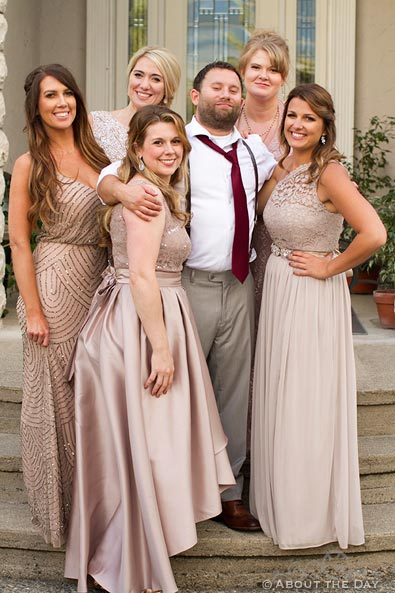 Groom poses with the Bridesmaids