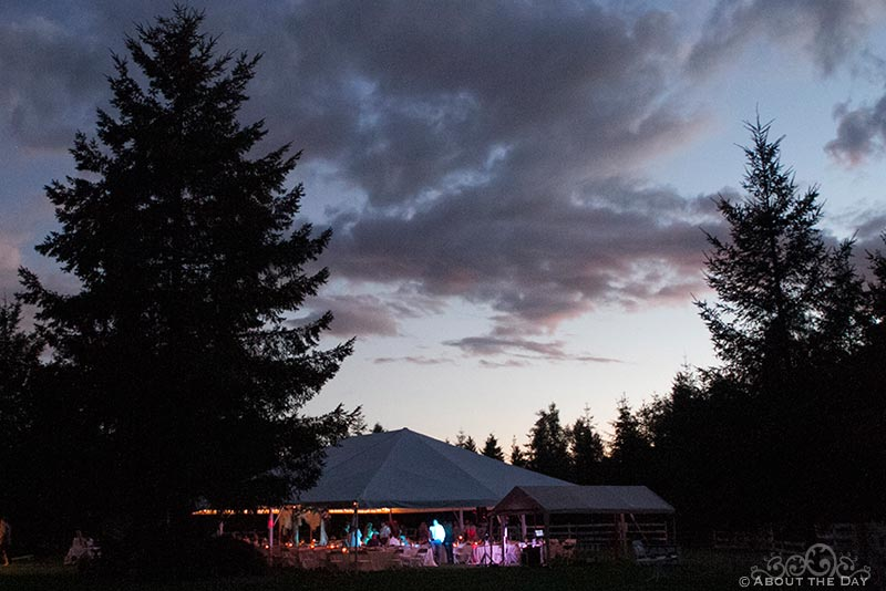 A view of the wedding tent after sunset