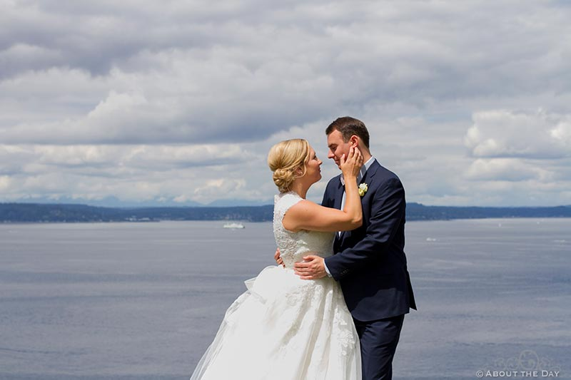 Bride and Groom almost kiss with a view of Puget Sound in the background