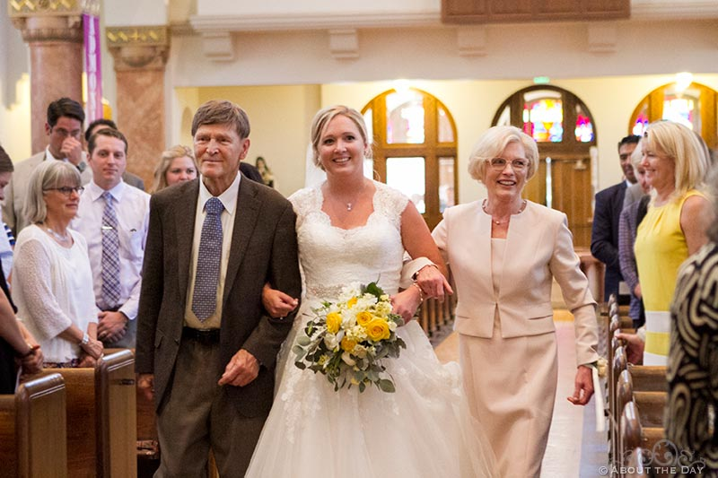 Father and Bride walk down the isle at Holy Rosary Catholic Church in Seattle, Washington