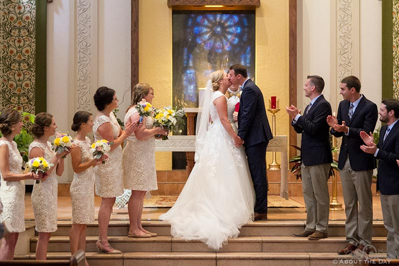 Bride and Groom kiss at Holy Rosary Catholic Church in Seattle, Washington