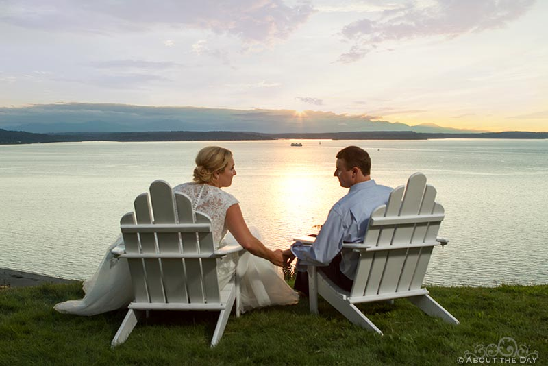Bride and Groom relax as the sun sets over Puget Sound