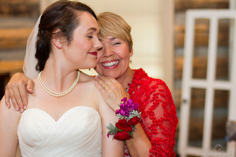 Mom gives bride a tearful smile at Trinity Tree Farm in Issaquah, Washington