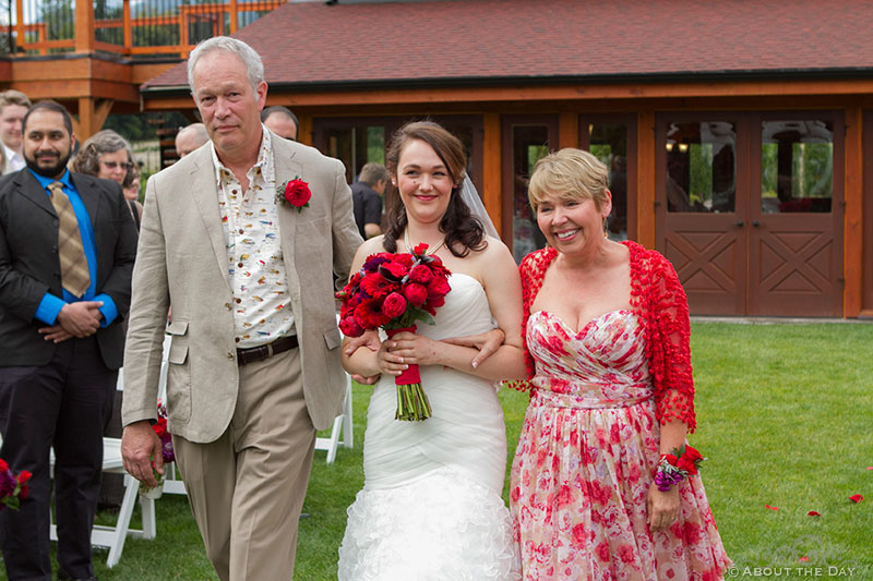 Mom and Dad walk Bride down the isle at Trinity Tree Farm in Issaquah, Washington