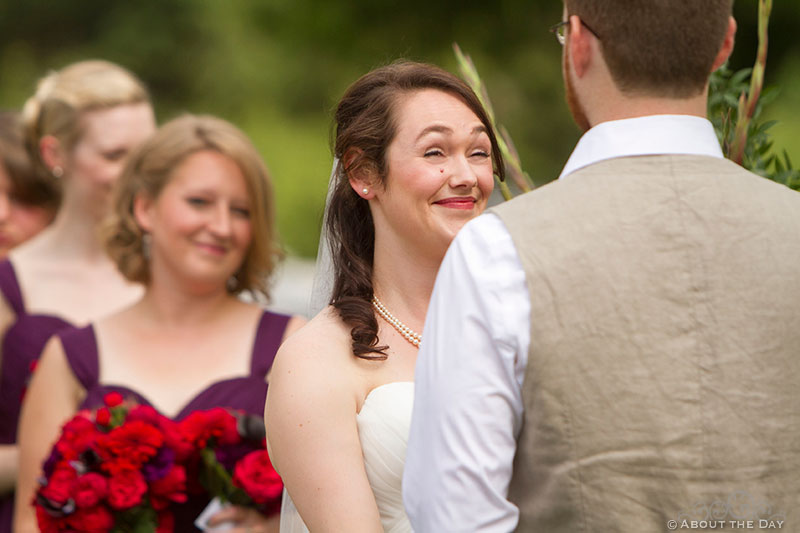 Bride smiles during vows at Trinity Tree Farm in Issaquah, Washington