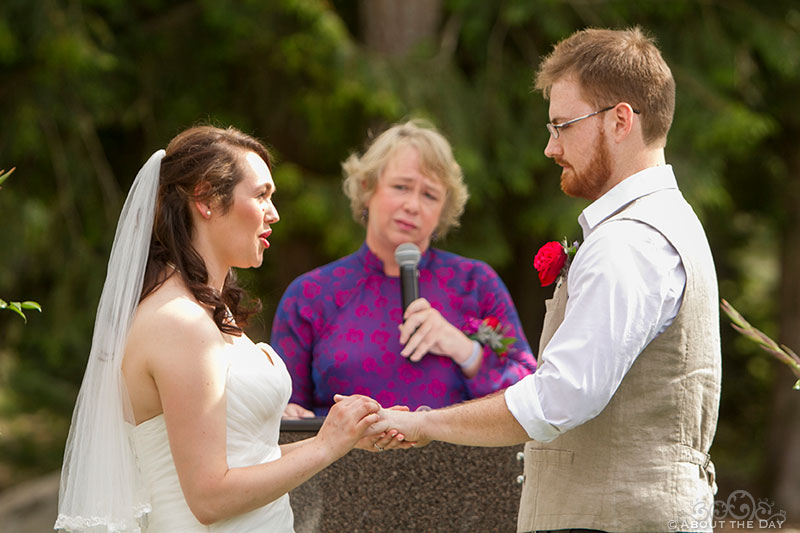 Bride and Groom exchange rings at Trinity Tree Farm in Issaquah, Washington