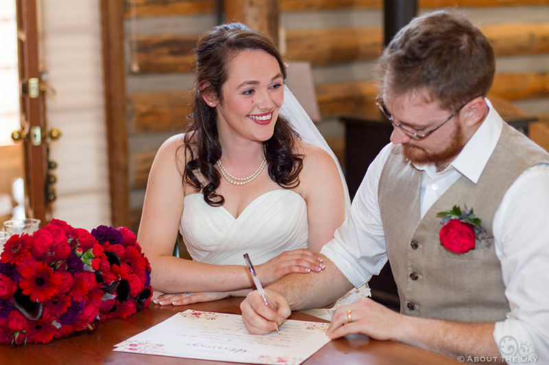 Bride and Groom sign mariage license at Trinity Tree Farm in Issaquah, Washington