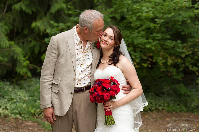 Father kisses Bride at Trinity Tree Farm in Issaquah, Washington