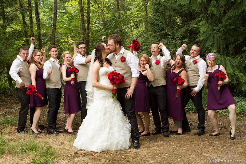 Wedding party cheer as Bride and Groom kiss at Trinity Tree Farm in Issaquah, Washington