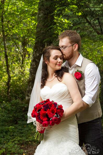 Bride and Groom snuggle at Trinity Tree Farm in Issaquah, Washington