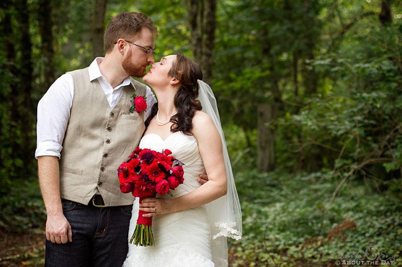 Bride and Groom kiss at Trinity Tree Farm in Issaquah, Washington