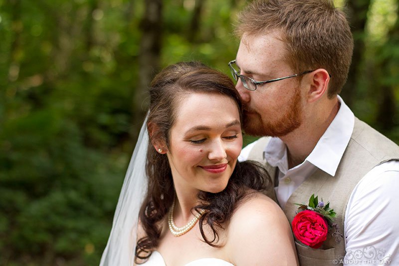 Bride and Groom snuggle up close at Trinity Tree Farm in Issaquah, Washington