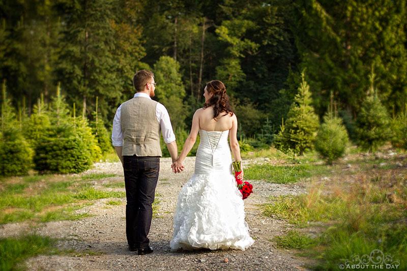 Bride and Groom walk down path at Trinity Tree Farm in Issaquah, Washington