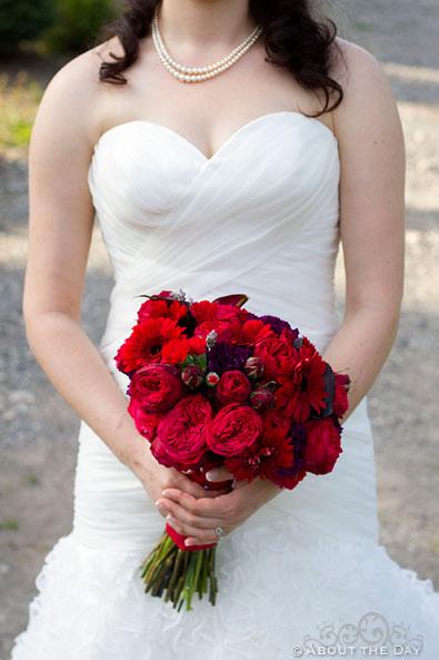Bride holds boquet at Trinity Tree Farm in Issaquah, Washington