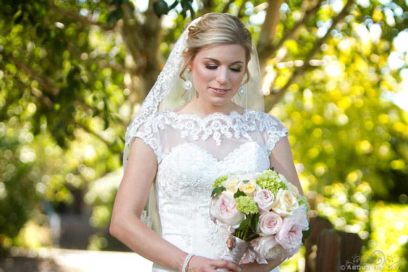 Beautiful Bride stands in the trees at Hidden Meadows