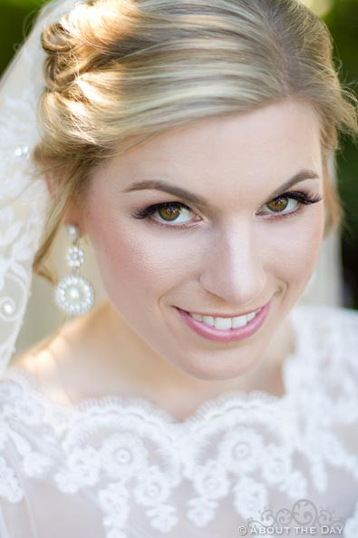 Stunning bride gazes up at the camera