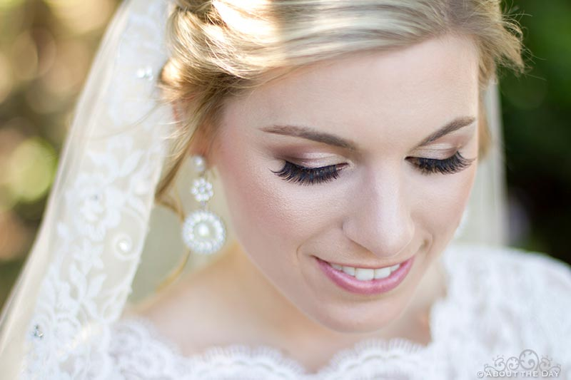 Bride shows flawless makeup and beautful skin