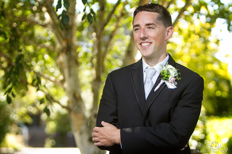 Groom enjoys posing on wedding day