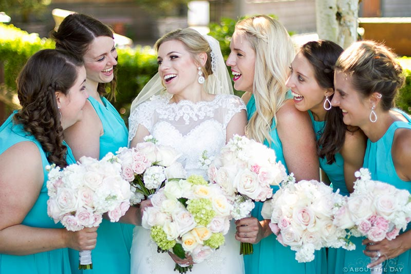 Bride with her wedding party in blue
