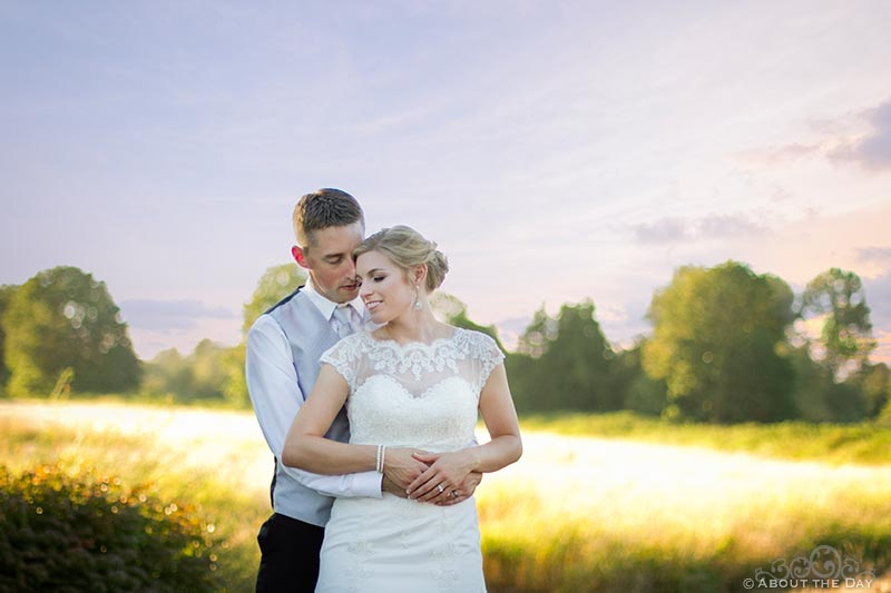 Bride and Groom get closer in sunset at Hidden Meadows